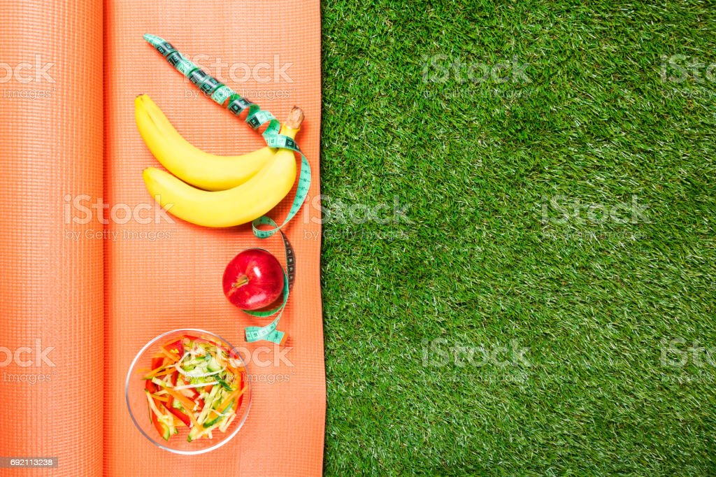 set of sports nutrition on the Mat , concept on green grass stock photo