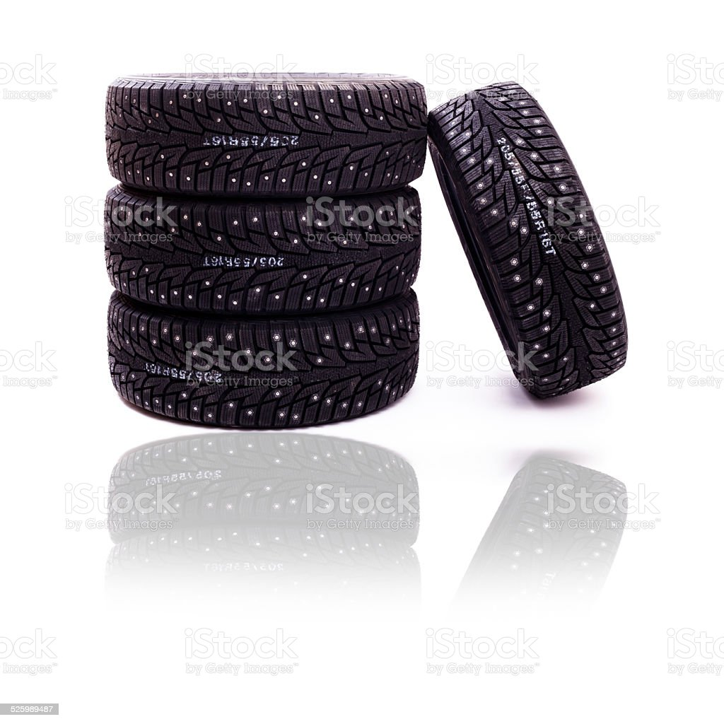 Set of studded winter tires isolated on white background stock photo