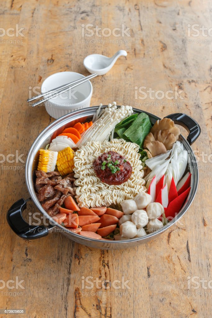 Set of Sukiyaki, Shabu with noodle and vegetable in the pot on wooden table photo libre de droits