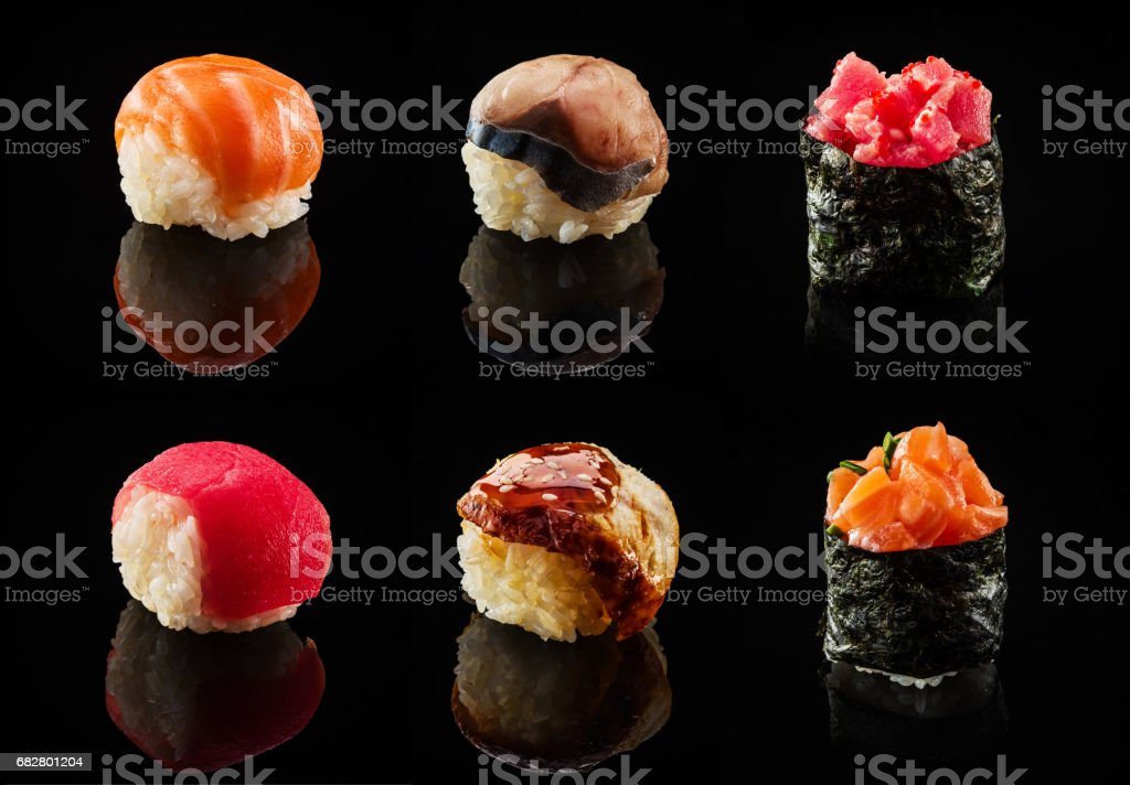 Set of sushi balls and maki rolls stock photo