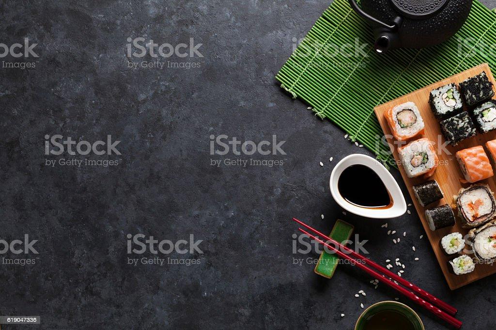 Set of sushi maki and green tea stock photo