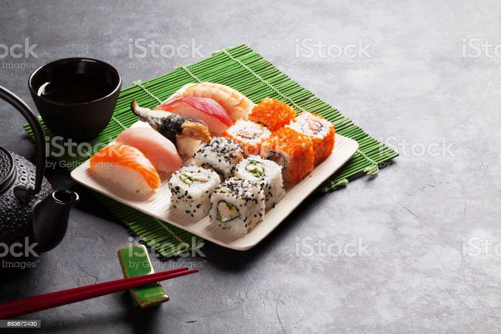 Set of sushi, maki and green tea stock photo