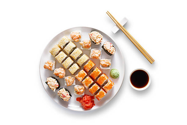 Set of sushi maki and rolls at black rustic wood stock photo