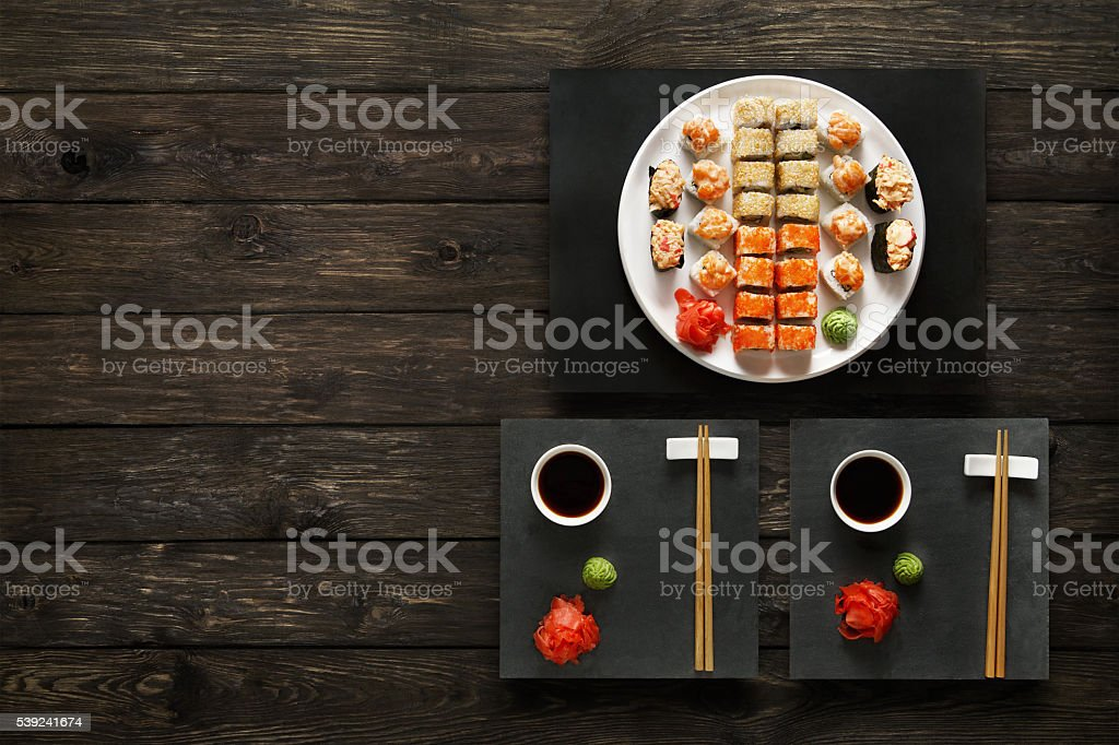 Set of sushi maki and rolls at rustic wood. royalty-free stock photo