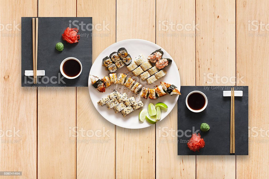 Set of sushi maki and rolls at wood. royalty-free stock photo