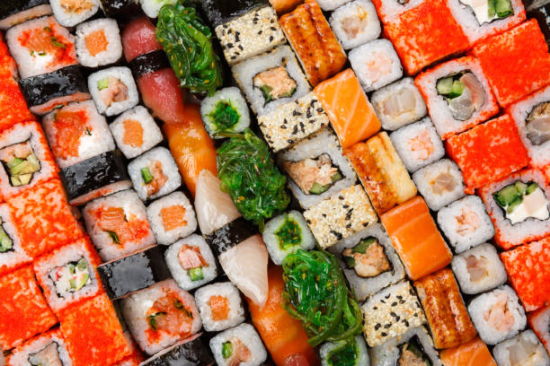 set of sushi, maki and rolls background - japanese food stock photos and pictures