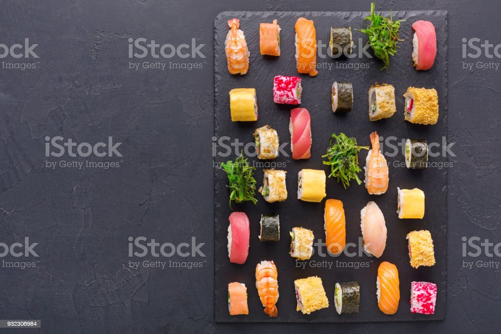 Set of sushi maki and rolls on gray background, top view stock photo