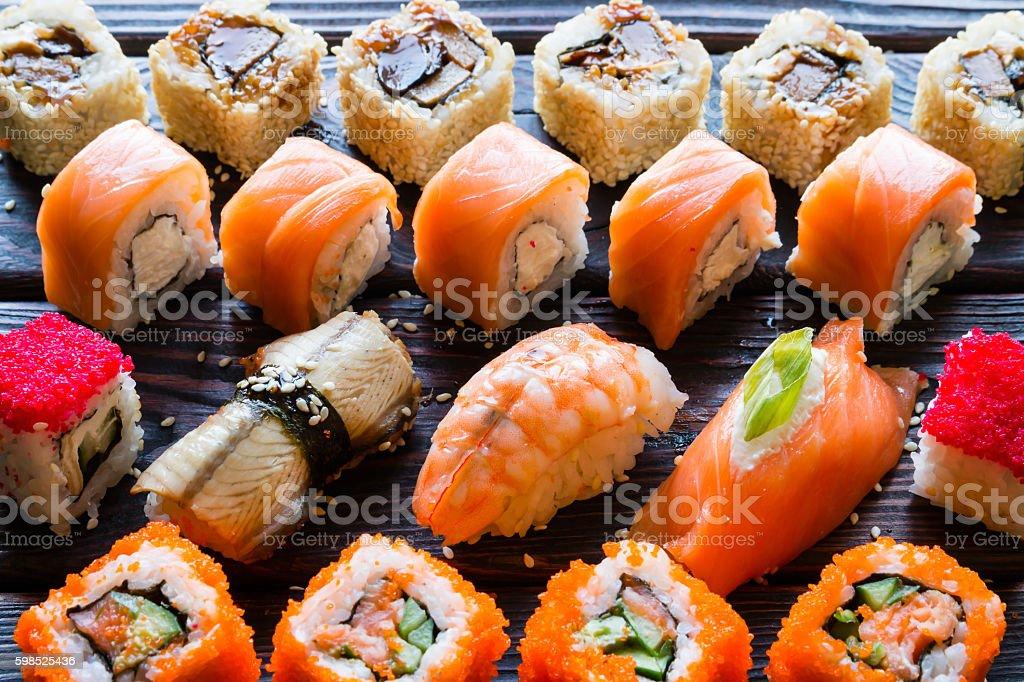 Set of sushi rolls and nigiri on a black background – Foto