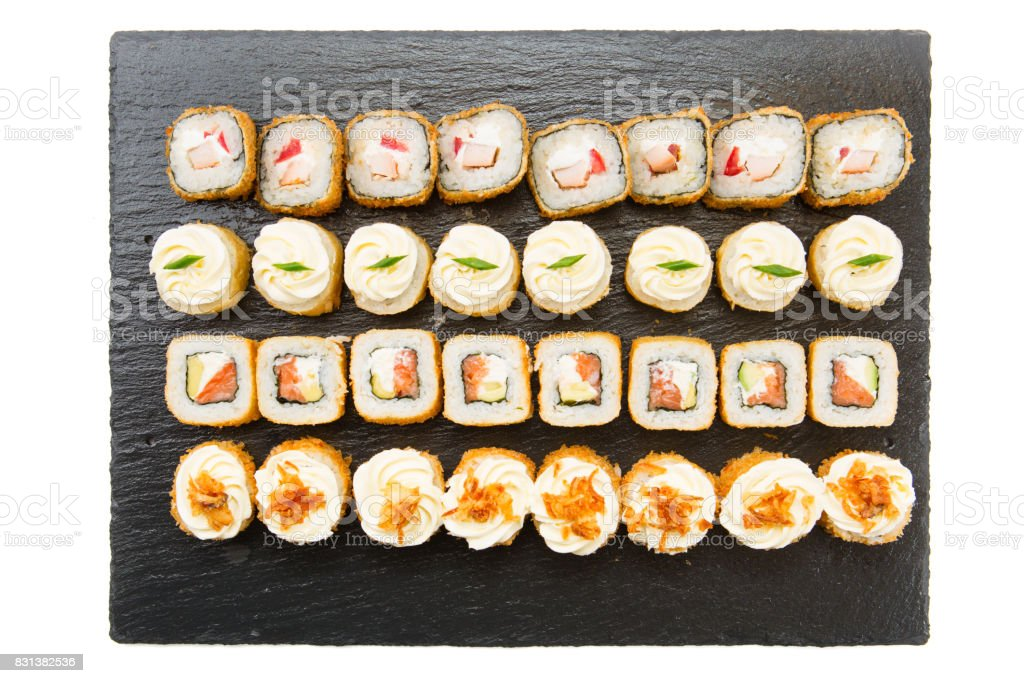 Set of Sushi rolls on a black background. Top view stock photo