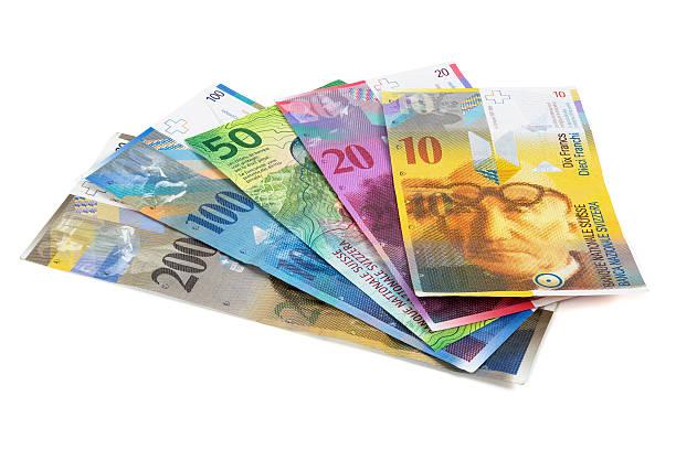 Set of swiss franc banknotes on white background stock photo