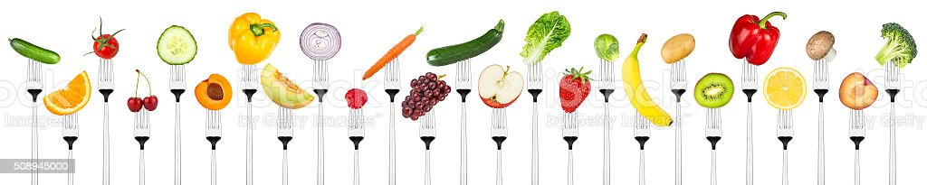 set of tasty fruits and vegetables on forks stock photo