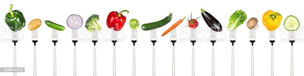 set of tasty vegetables on forks stock photo