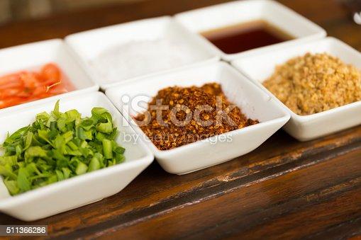 set of thailand condiment seasoning for rice gruel (fried garlic, dried chili, sugar, fish sauce, vinegar, vegetable)