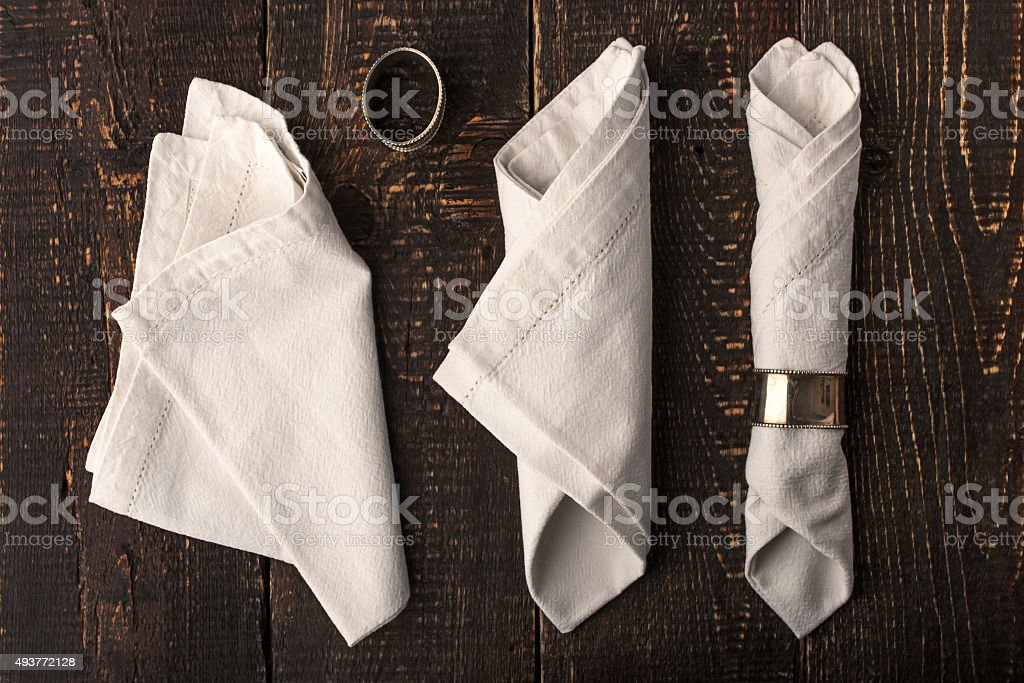 Set of the napkins with vintage ring top view stock photo