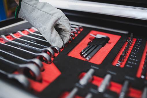 Set of the professional tools. Closeup of chrome wrench tools organized in box.