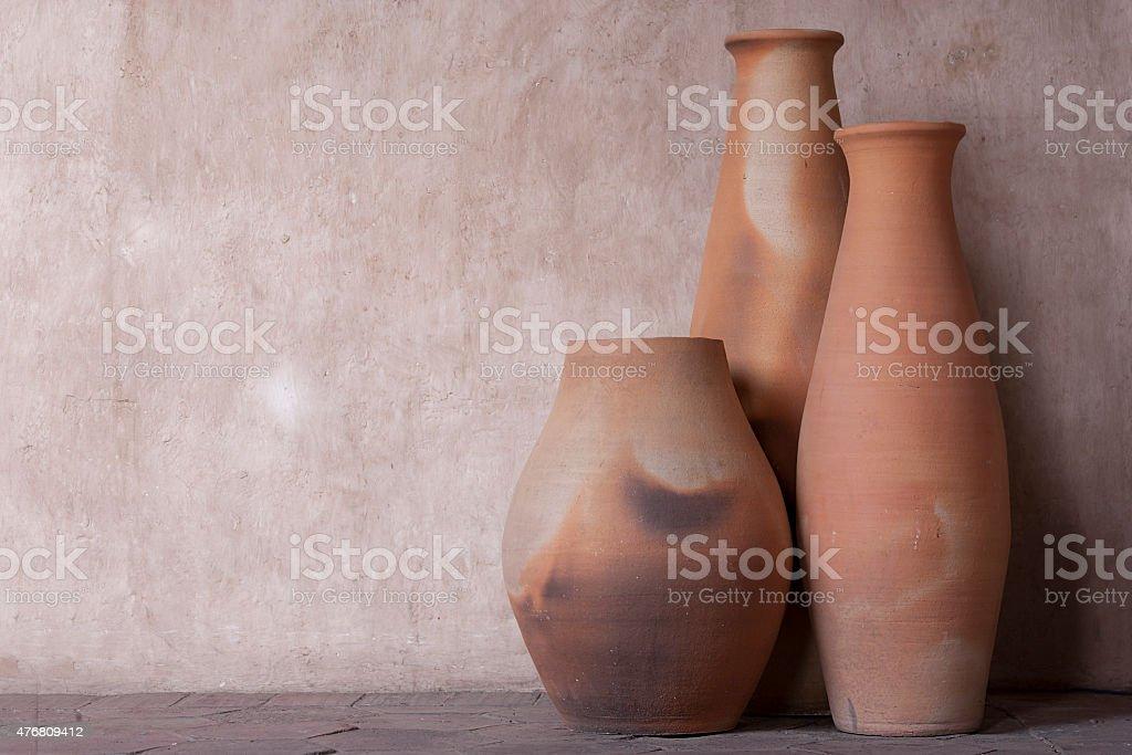 Set of three clay pots stock photo