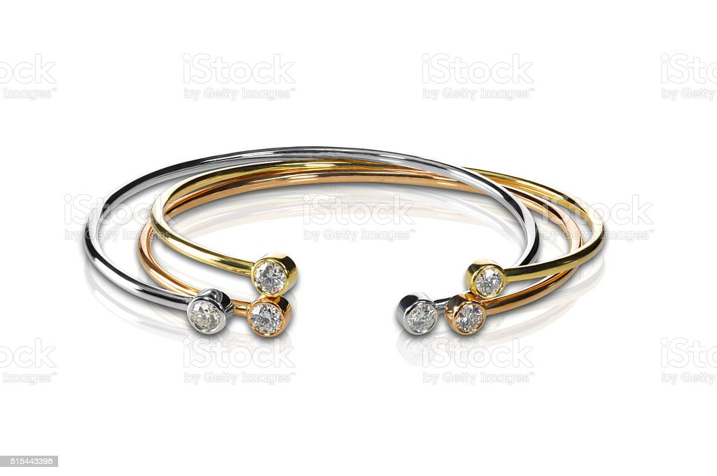 Set of three colored gold and diamond bracelets stacked stock photo