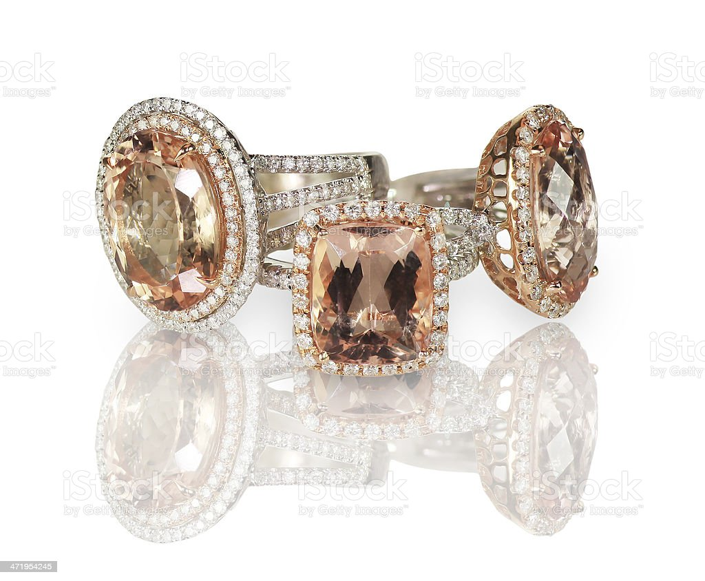 Set of three diamond and pink gemstone fashion engagment rings. stock photo