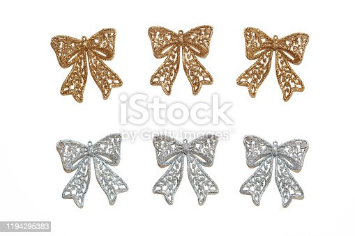 istock Set of three golden bows and three silver bows on an isolated background. View from above. 1194295383