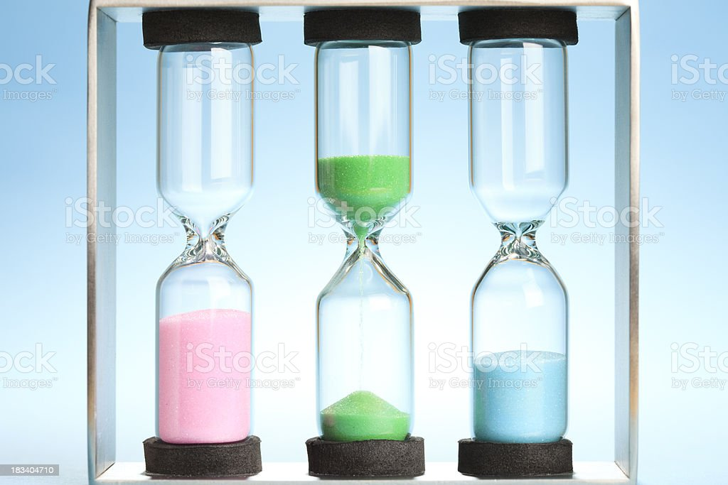 Set of three sandtimers (hourglasses) stock photo