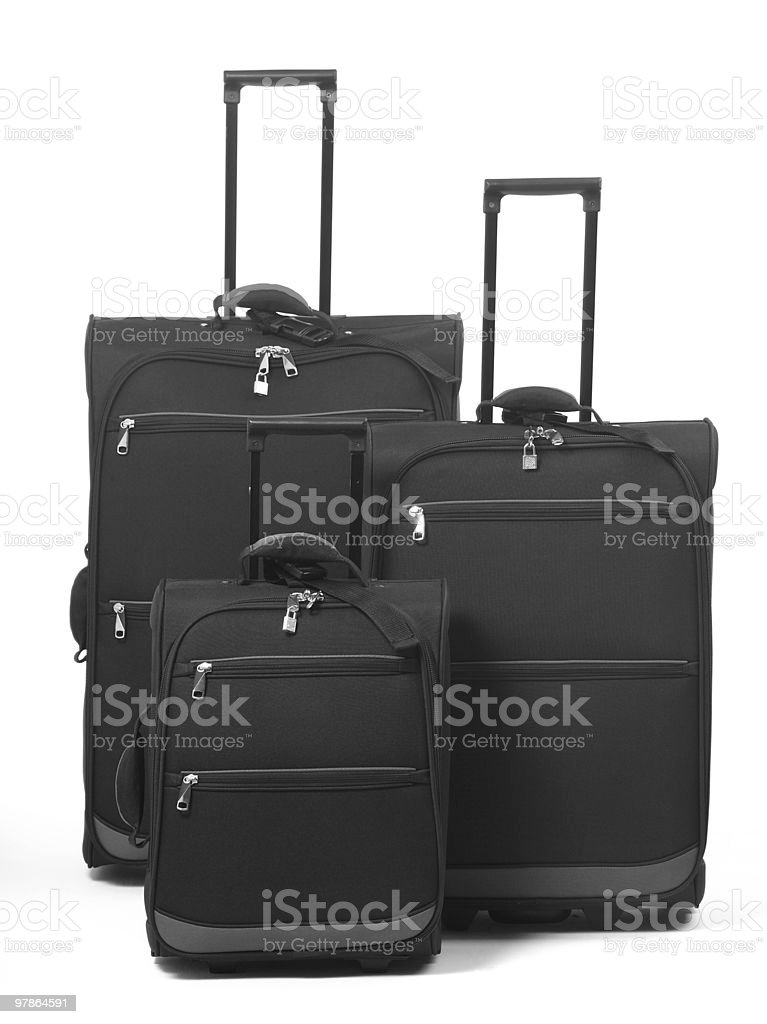 Set of three suitcases against a white background royalty-free stock photo