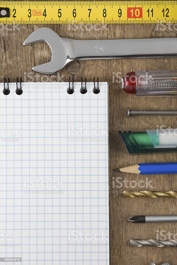 set of tools and notebook on wood royalty-free stock photo