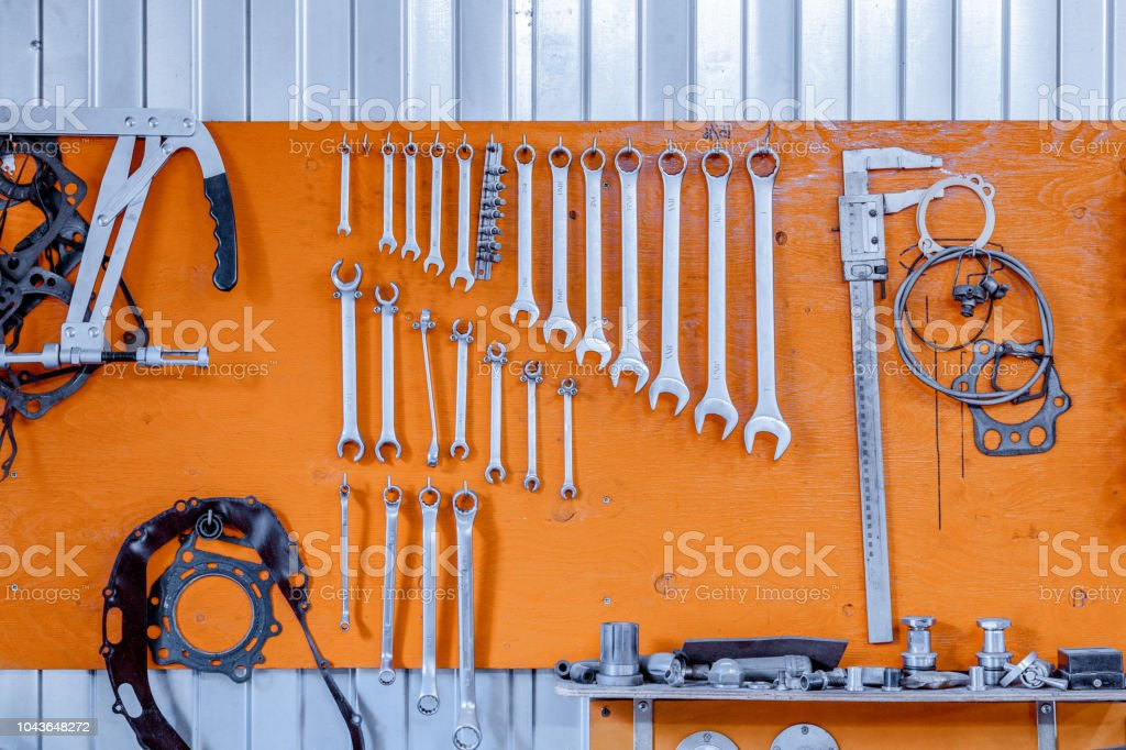 Set of tools as business cards on an orange background.