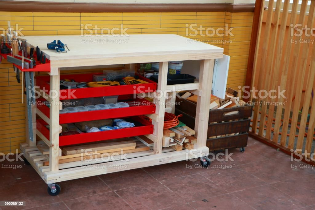 Set of tools for woodworking on workbench with wheeled vehicle stock photo