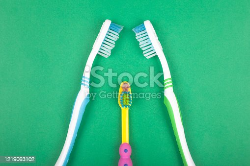 istock set of toothbrushes for the whole family on green background, oral hygiene 1219063102