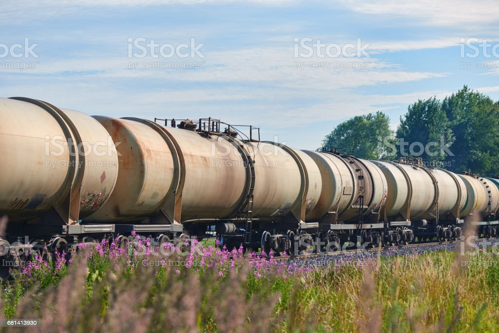 Set of train tanks with oil and fuel transport by rail - countryside view stock photo