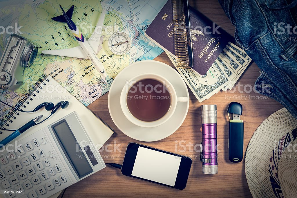 Set of travel accessory on wooden background stock photo