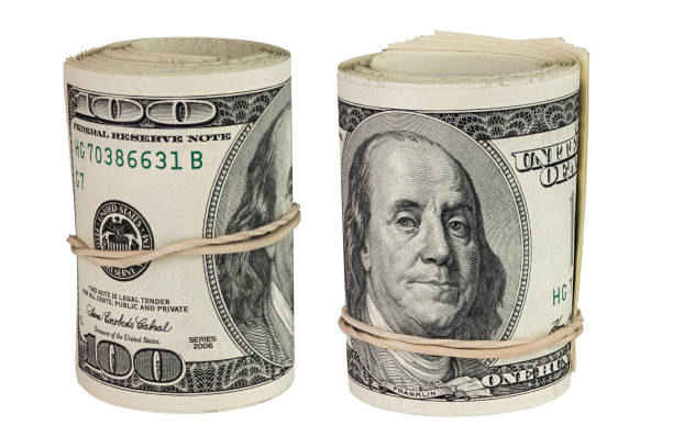 set of two rolls of hundred us dollars standing up and isolated on white background stock photo