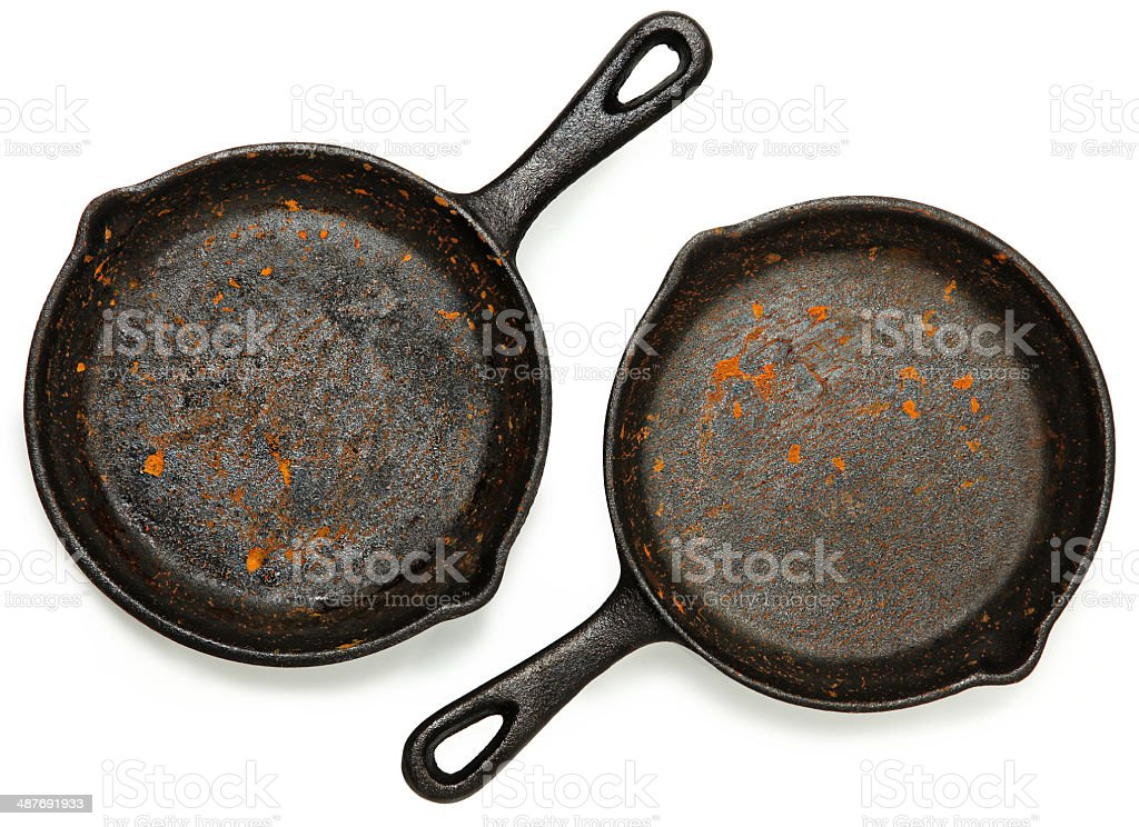 Set of Two Rusty Cast Iron Skillets stock photo