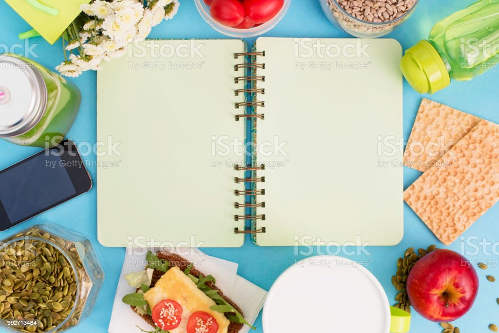 A set of useful products, cherry Tomato, apple fruit Seeds Plastic Tableware White Flowers Fresh Salad stock photo