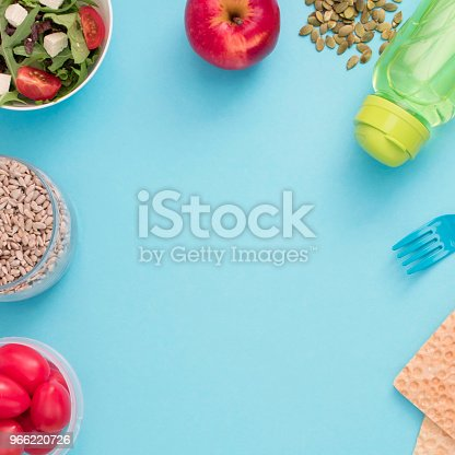 istock A set of useful products, cherry Tomato, apple fruit Seeds Plastic Tableware White Flowers Fresh Salad 966220726