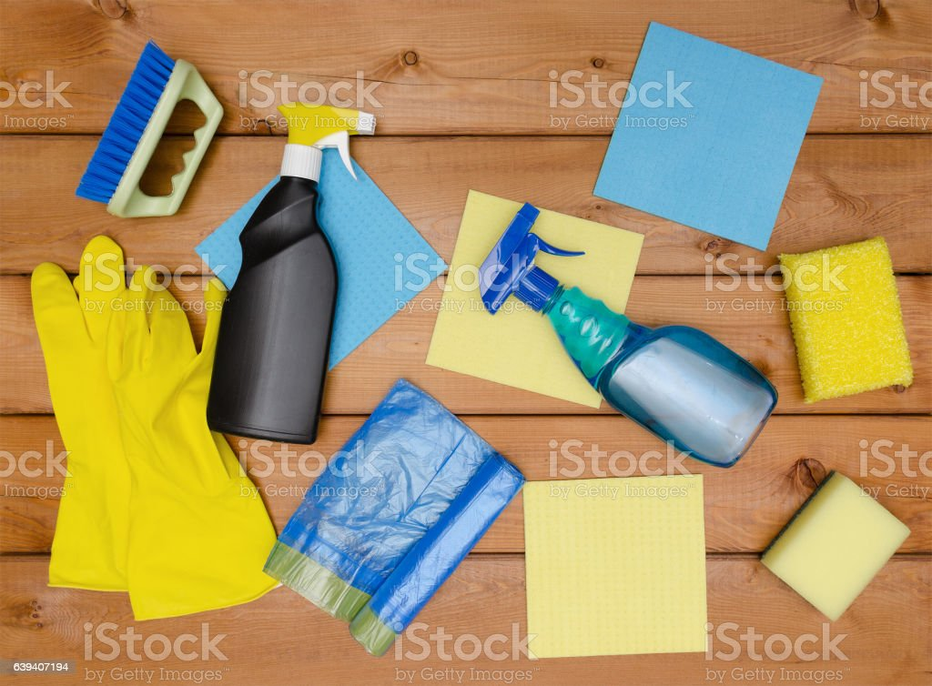 Set of variety cleaning supplies on wooden table stock photo