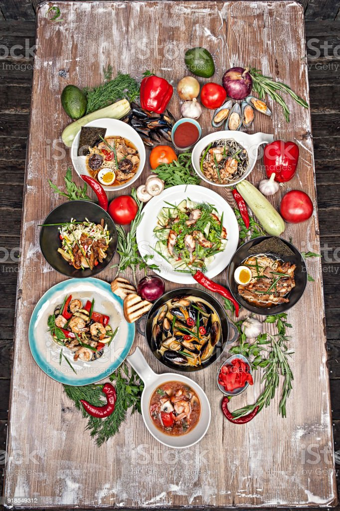 Set of various asian dishes , vegetables and herbs on a wooden table. stock photo