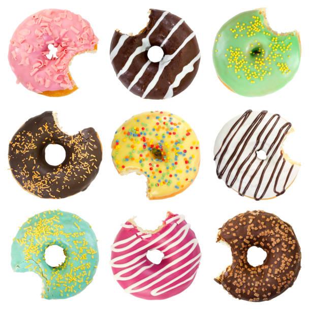satz von verschiedenen gebissen donuts - löcherkuchen stock-fotos und bilder