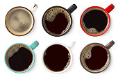 istock Set of various colorful cups of black coffee 1169132284
