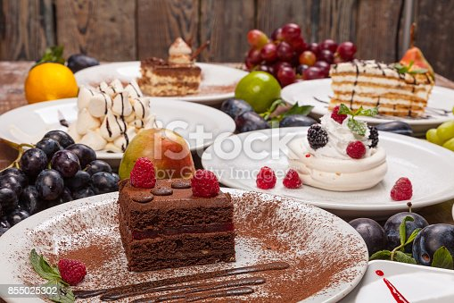 istock Set of various desserts on a wooden table decorated with fruits and berries. 855025302