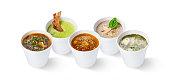 Collage of five different restaurant soups in cups, isolated on white background, cutout for menu