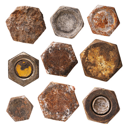 Set of various rusty heads of bolts and nuts isolated on a white background