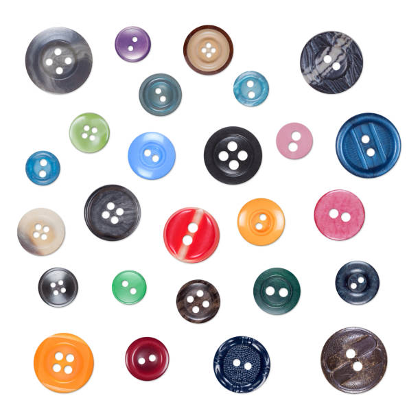Set of Various Sewing Colourful Plastic Buttons, Isolated on White Background with Shades stock photo