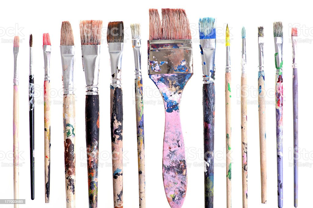 Set of various sized dirty brushes stock photo