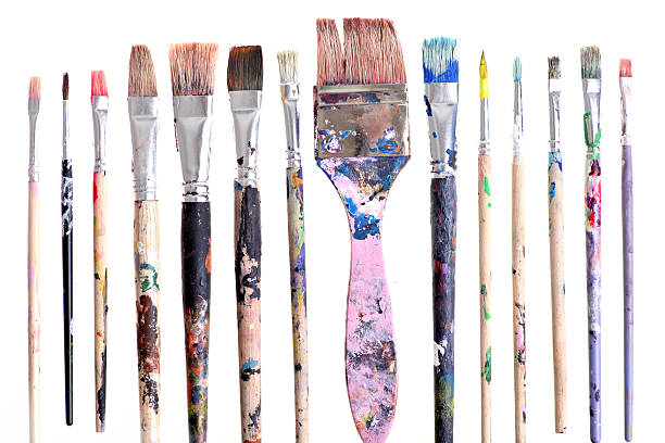 Set of various sized dirty brushes Various dirty paint brushes displayed side by side paintbrush stock pictures, royalty-free photos & images