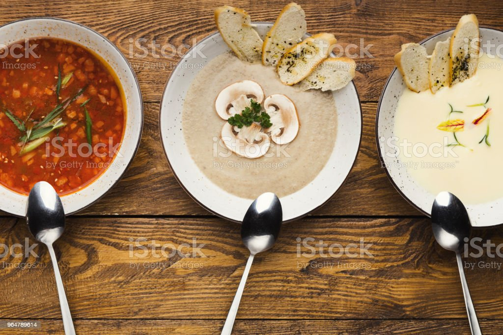 Set of various soups on wooden background, top view royalty-free stock photo
