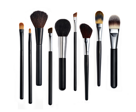 Make-up Brushes on white background.