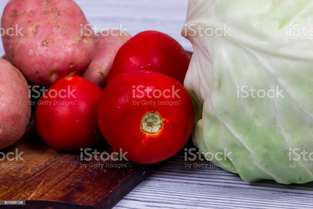 Set of vegetables cabbage potatoes on a wooden table background stock photo