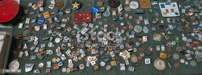 Set of vintage original icons of the Soviet Union, top view. Metal Badges Russian.