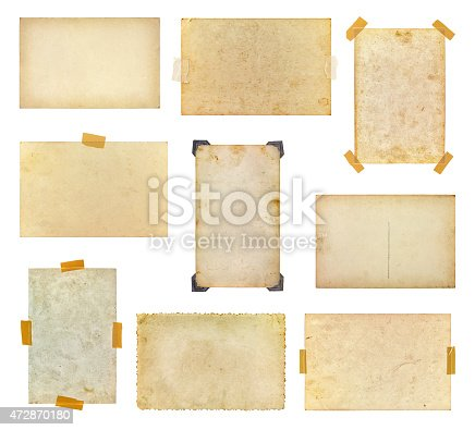 istock Set of vintage photos taped to a white background 472870180
